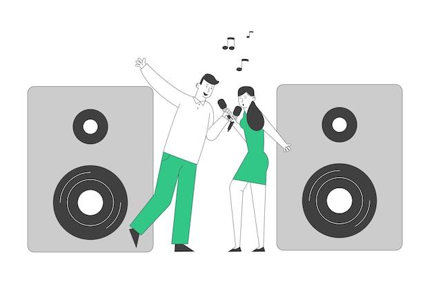 Cheerful couple singing song with microphones near huge dynamics in karaoke bar or nightclub.