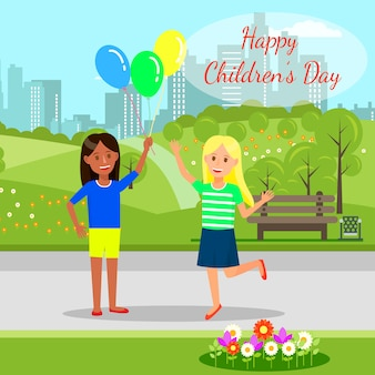 Cheerful girls holding balloons in hands at park.