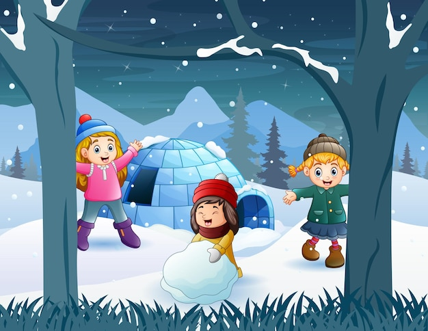 Cheerful kids playing a snow near the igloo house