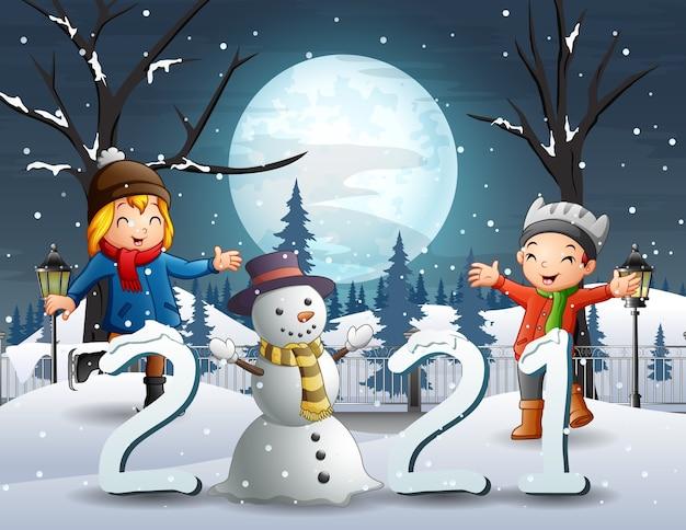 Cheerful kids in winter night landscape