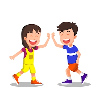 Cheerful little boy and girl doing high five