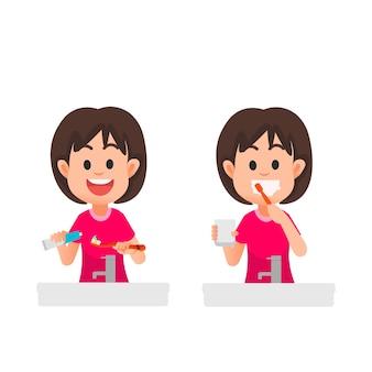 Веселая маленькая девочка чистит зубы
