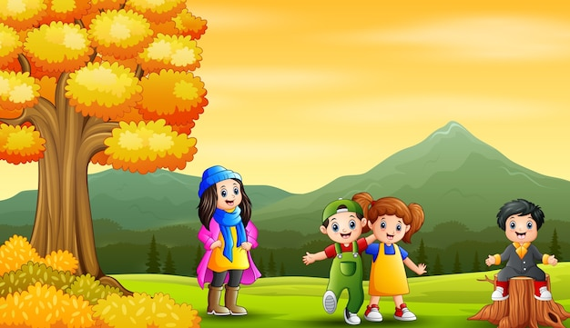 Cheerful little kids in autumn landscape