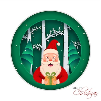 Cheerful santa claus character holding a gift box on green and white paper cut nature background for merry christmas celebration.