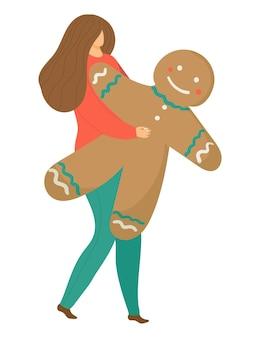 陽気な女性キャラクターがクリスマスジンジャーブレッドマンを保持します