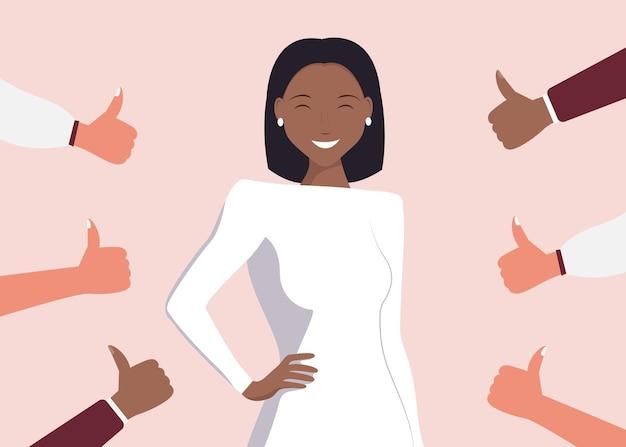 親指を立てて囲まれた陽気な若い黒人女性。公の承認、聴衆の認識、肯定的な意見