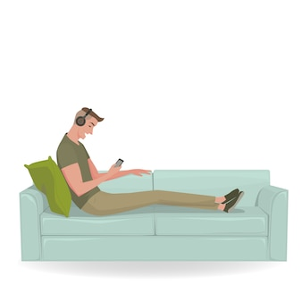 Cheerful young man relax on a green sofa
