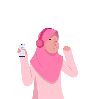 Cheerfull young hijab girl listening music