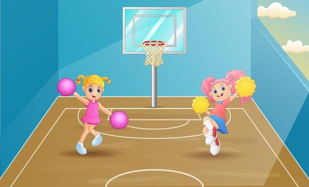 Cheerleaders dancing on basketball court