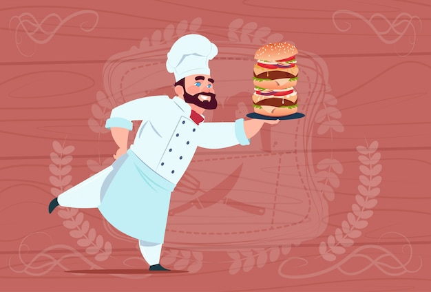 Chef cook hold big burger smiling cartoon restaurant chief in white uniform over wooden textured background