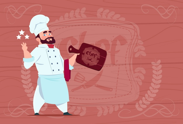 Chef cook hold board smiling cartoon restaurant chief in white uniform over wooden textured background