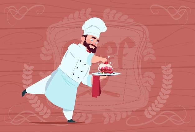 Chef cook holding dessert dish smiling cartoon chief in white restaurant uniform over wooden textured background