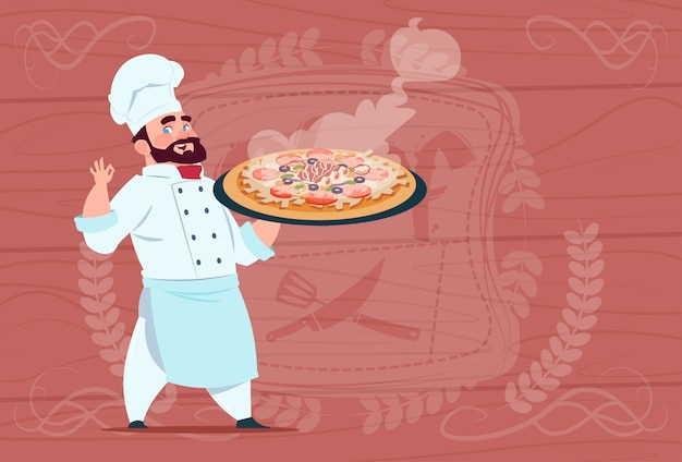 Chef cook holding pizza smiling cartoon chief in white restaurant uniform over wooden textured background