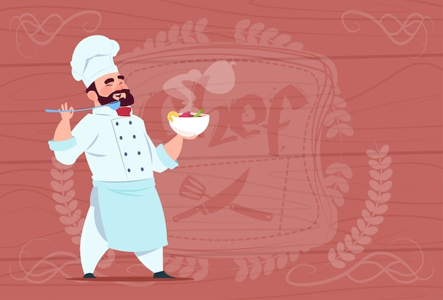 Chef cook holding plate with hot soup smiling cartoon chief in white restaurant uniform over wooden textured background