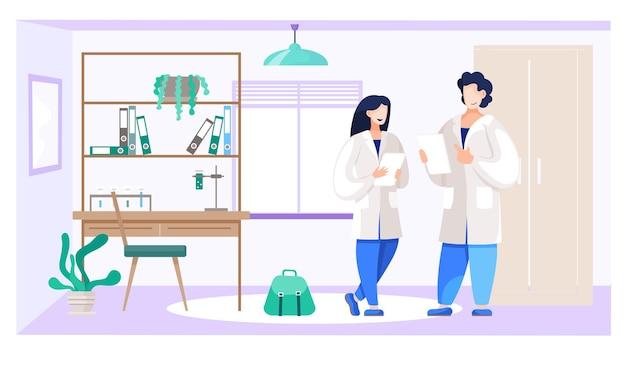 화학 학생들은 실험실에서 의사 소통합니다.