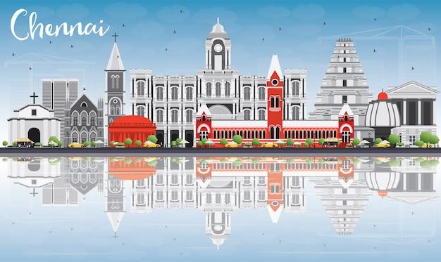 Chennai skyline with gray landmarks, blue sky and reflections.