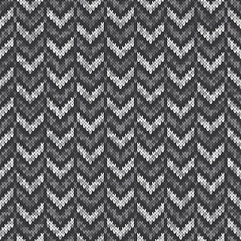 Chevron abstract knitted sweater pattern. vector seamless background with shades of gray colors. wool knit texture imitation.