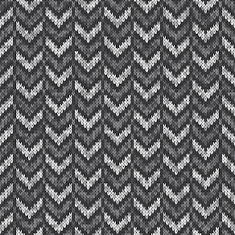 Шеврон абстрактный узор вязаный свитер. вектор бесшовный фон с оттенками серого цвета. имитация текстуры шерсти.
