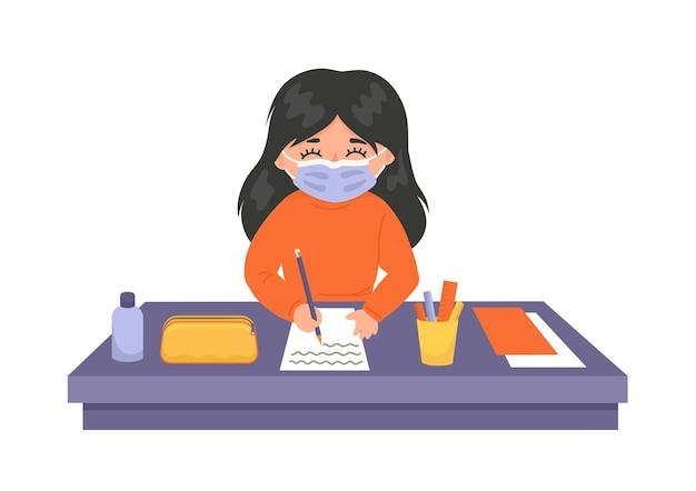 コロナウイルス病を予防するために医療用マスクを着用している学校の子供