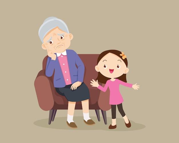 Child consoling sad elderly woman sitting alone on sofa