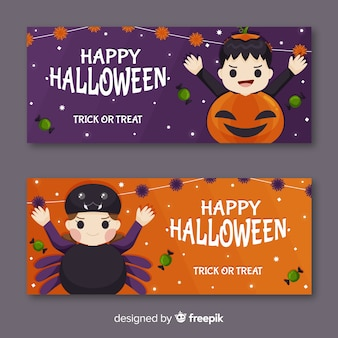 Child dressed for halloween banners