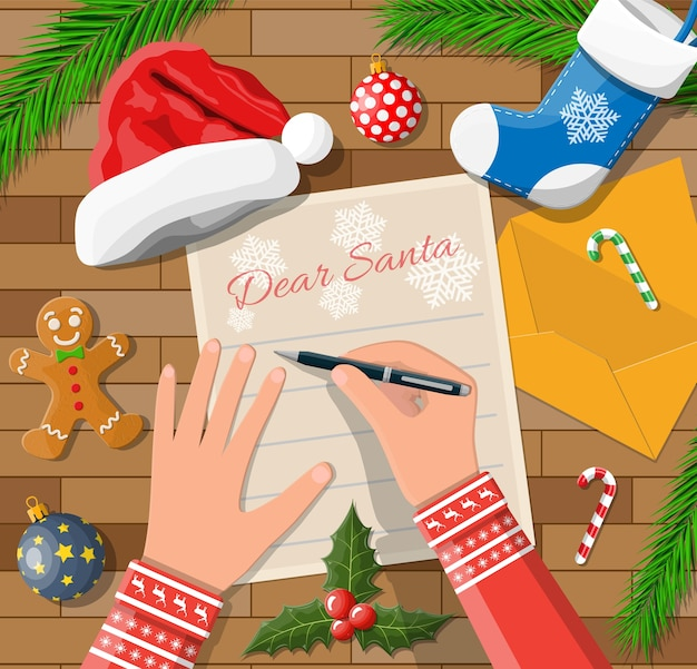 Child hand pen writing letter to santa claus