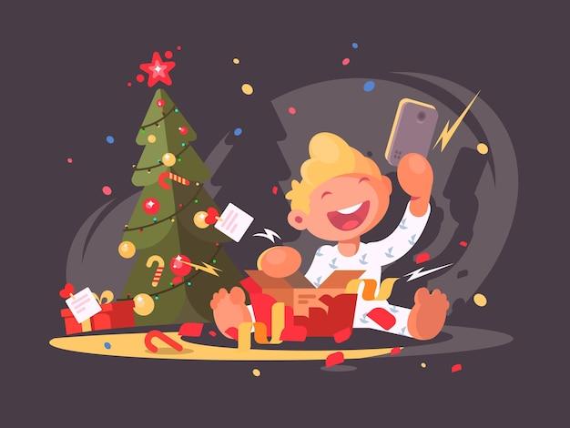 아이가 크리스마스 선물을 엽니다. 선물 상자에 스마트폰입니다. 벡터 일러스트 레이 션