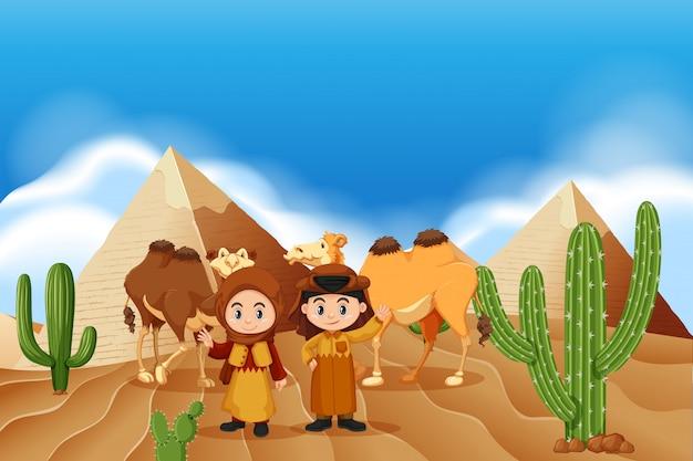 砂漠の子供たちとラクダ