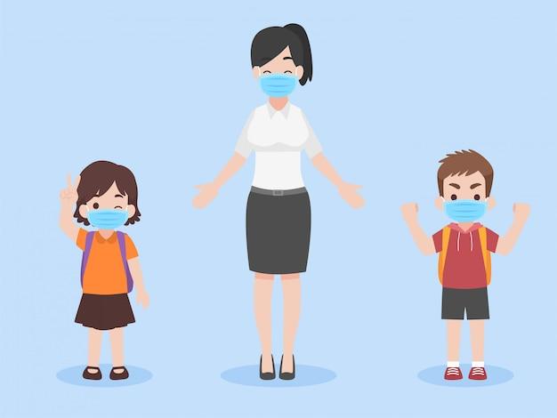 コロナウイルスを防ぐためにフェイスマスクを身に着けている新しい通常の生活の子供と教師、学校のコンセプトに戻る。