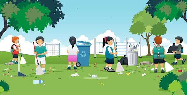 子供たちは遊び場のある公園で掃除をしています