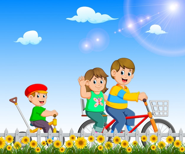 The children are playing and riding the bicycle together in the garden