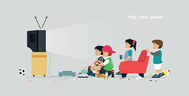 子供たちは灰色の背景でビデオゲームをプレイしています