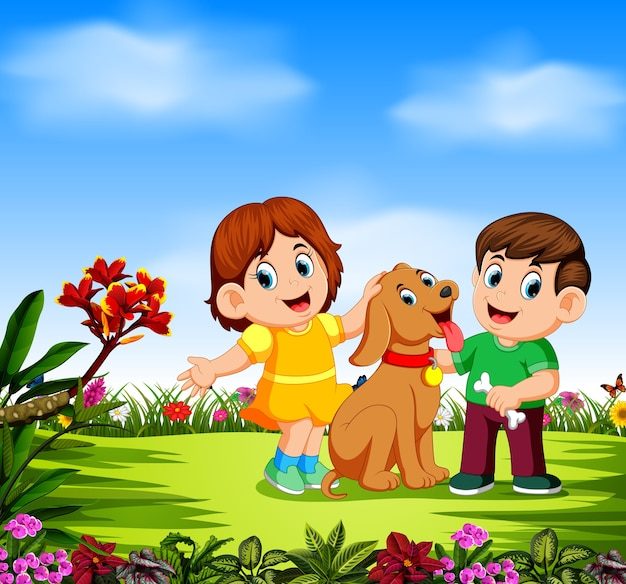 Children are playing with their dog around the flowers