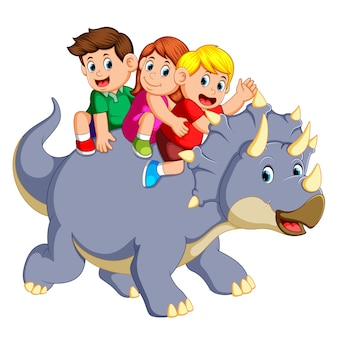 Children are sitting on the triceratops and waving their hand when it move