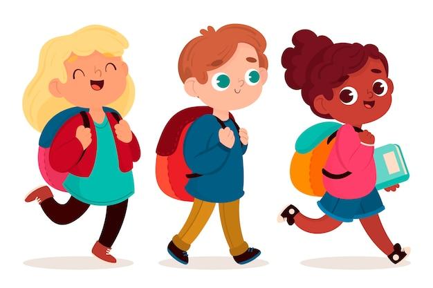 I bambini tornano a scuola in design piatto