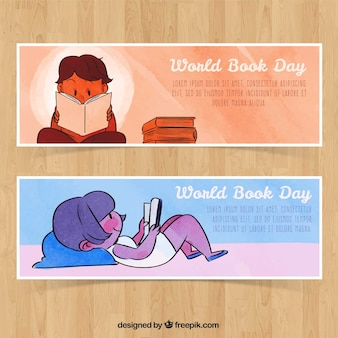 Children banners reading a book