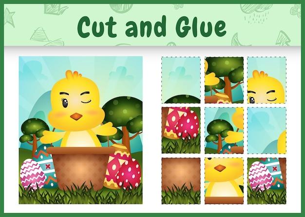 子供のボードゲームは、バケツの卵のかわいいひよこと一緒にテーマのイースターをカットして接着します