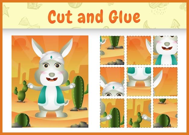 어린이 보드 게임은 아랍어 전통 의상을 사용하여 귀여운 토끼로 테마 부활절을 자르고 붙입니다.