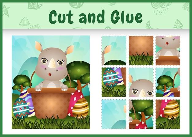 어린이 보드 게임은 양동이 달걀에 귀여운 코뿔소로 테마 부활절을 자르고 붙입니다.