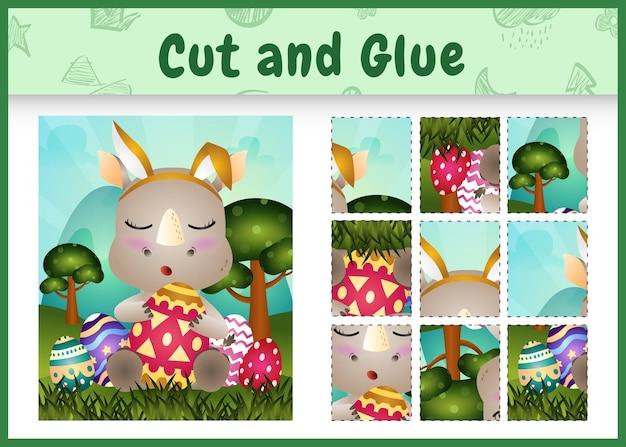 어린이 보드 게임은 토끼 귀 머리띠를 사용하여 귀여운 코뿔소로 테마 부활절을 자르고 붙입니다.