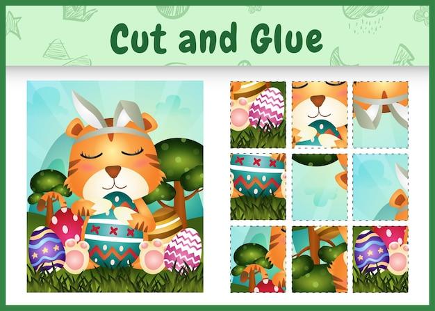 Детская настольная игра вырезать и приклеить тематическую пасху с милым тигром, используя повязки на голову с кроличьими ушками, обнимая яйца