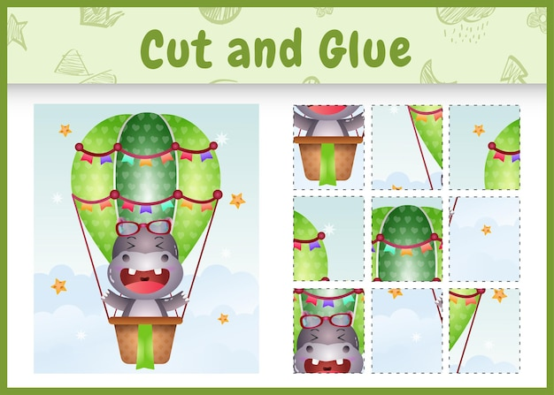 Children board game cut and glue with a cute hippo on hot air balloon