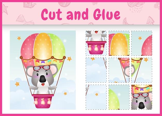 Children board game cut and glue with a cute koala on hot air balloon