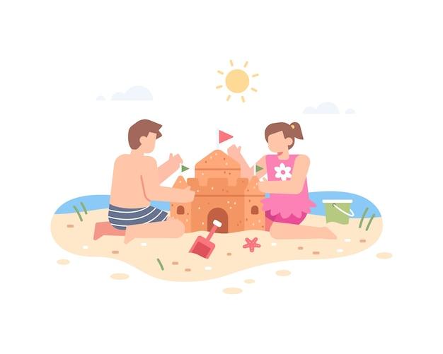 아이들이 해변에 모래성을 짓다