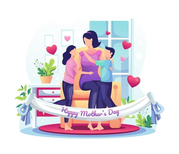 아이들은 집에서 어머니와 함께 어머니의 날을 축하합니다.