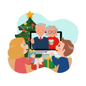 Children celebrating christmas with their grand parents via online video call. stay safe at home during christmas and new year.