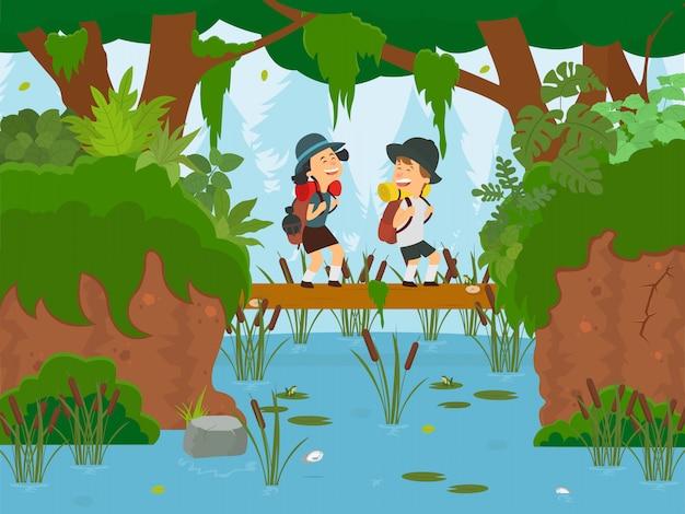 子供たちは森の川のログを渡ります。
