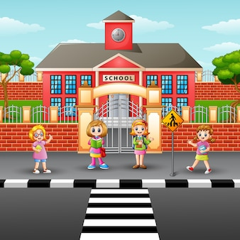 Дети, пересекающие улицу в передней школе
