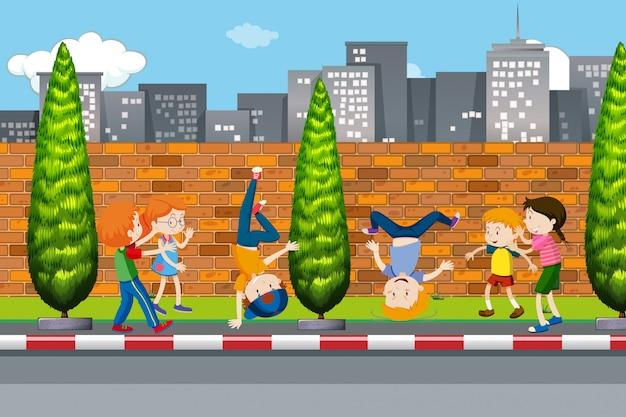 Children dancing on street