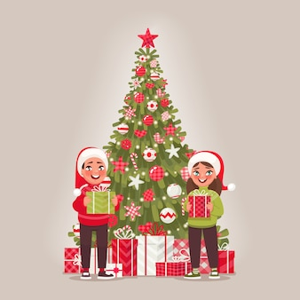 Children and decorated christmas tree. a boy and a girl are holding gifts. merry christmas and happy new year